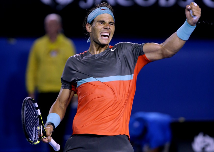 Rafael Nadal of Spain celebrates after defeating Roger Federer of Switzerland during their semifinal at the Australian Open tennis championship in Melbourne, Australia, Friday, Jan. 24, 2014. (AP Photo/Aaron Favila)