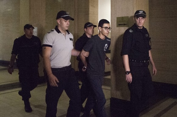 epa05470295 French national Mourad Hamyd (2-R) is escorted by Bulgarian Police officers in the court halls before his trail in Sofia, Bulgaria, 10 August, 2016. Hamyd is the brother-in-law of one of the men who attacked the French satirical magazine Charlie Hebdo in Paris in January 2015. On 28 July, Mourad Hamyd entered into Turkey but the Turkish authorities returned him to Bulgaria because he was banned from entering Turkey's territory for a 5-years term. He was suspected of trying to join extremists in Syria and was detained in Bulgaria. During his trial today he asked to be extradited to France under the Extradition Act and European arrest warrant after Fance issued an arrest warrant for him.  EPA/STR