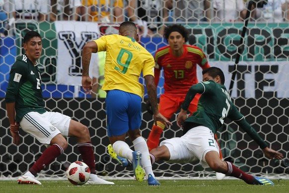 Brazil's Gabriel Jesus, center, Mexico's Jesus Gallardo, left, and Mexico's Hugo Ayala challenge for the ball during the round of 16 match between Brazil and Mexico at the 2018 soccer World Cup in the Samara Arena, in Samara, Russia, Monday, July 2, 2018. (AP Photo/Frank Augstein)