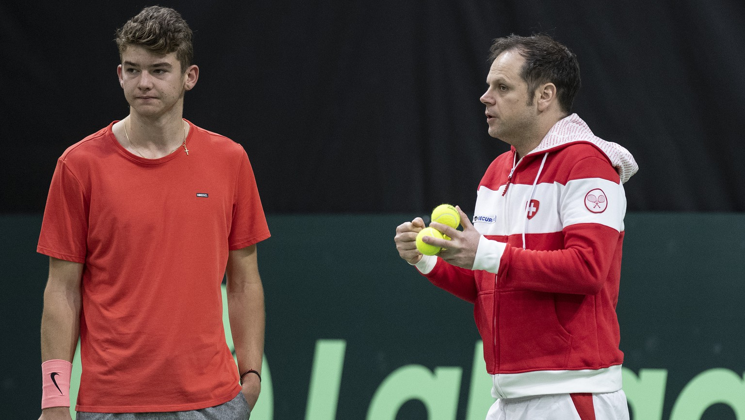 Switzerland's Davis Cup team captain Severin Luethi, right, and his team player Jerome Kym, left, look on during a training session in the Swiss Tennis Arena in Biel, Switzerland, on Thursday, January 31, 2019. Switzerland will be face Russia in the tennis Davis Cup qualification final round. (KEYSTONE/Peter Schneider)