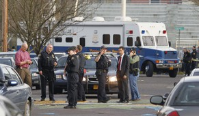 Police investigate outside the Rosemary Anderson High School in Portland, Oregon December 12, 2014. Three teenagers were shot on Friday outside the high school, police said, and officers were searching for at least one suspect who was believed to have left the scene following the gunfire. All three victims of the shooting outside Rosemary Anderson High School in north Portland, two boys and one girl, were