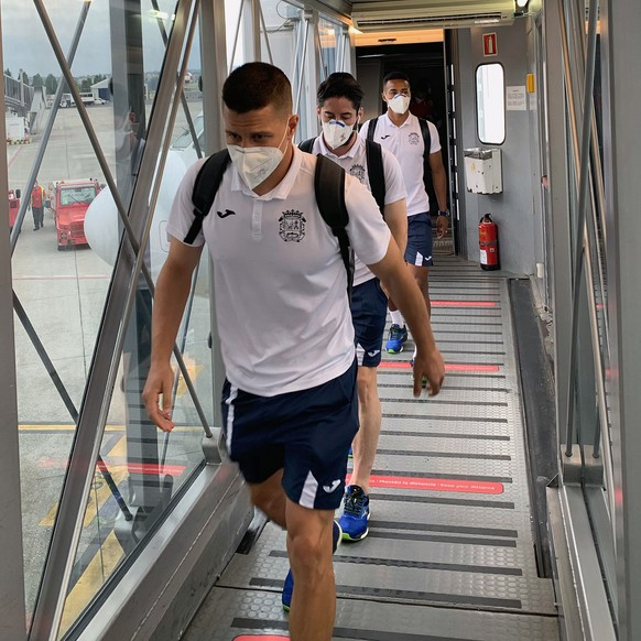 epa08558389 A handout photo made available by Spanish soccer team CF Fuenlabrada shows Fuenlabrada players arriving at the airport in A Coruna, Spain, 20 July 2020 (issued on 21 July 2020). The Spanish Second Division team Fuenlabrada's match against Deportivo Coruna was suspended after several of its players were tested positive for the COVID-19 disease.  EPA/CF FUENLABRADA / HO  HANDOUT EDITORIAL USE ONLY/NO SALES/NO ARCHIVES