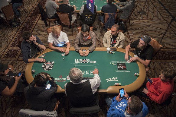 In this photo taken Monday, July 11, 2016, poker players compete at the Main Event of the World Series of Poker at the Rio Convention Center in Las Vegas on . (Martin S. Fuentes/Las Vegas Review-Journal via AP)