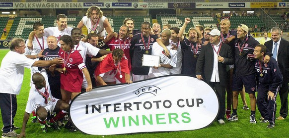 AC Perugia's players celebrate after defeating VfL Wolfsburg in their UEFA Intertoto Cup final 2nd leg soccer match in Wolfsburg, Germany, Tuesday 26 August 2003.EPA PHOTO DPA HOLGER HOLLEMANN