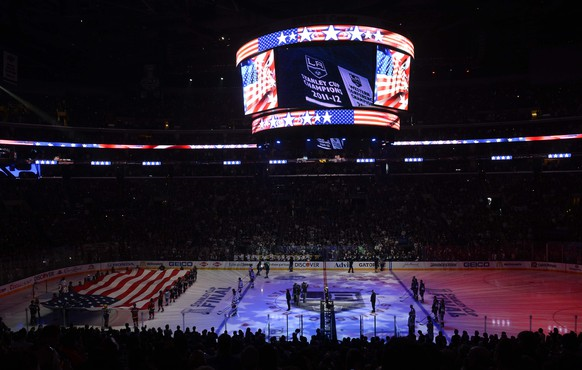 Jun 7, 2014; Los Angeles, CA, USA; A general view as a large American flag is unfurled on the ice during the playing of the national anthem before game two of the 2014 Stanley Cup Final between the New York Rangers and the Los Angeles Kings at Staples Center. Mandatory Credit: Richard Mackson-USA TODAY Sports