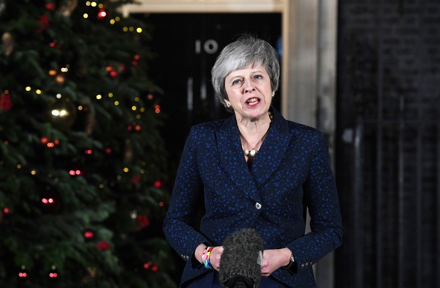 epa07227015 British Prime Minister Theresa May gives a statement outside 10 Downing Street after a Confidence Vote in London, Britain, 12 December 2018. Theresa May won a challenge to her leadership on 12 December 2018 after Conservative Members of Parliament voted in her favour in a Confidence Vote.  EPA/ANDY RAIN