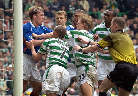 Rangers Peter Lovenkrands, left, and Celtic's Henrik Larsson, 2nd left, and Johan Mjallby, 3rd left, have an altercation as referee Kenny Clark, left, tries to separate them near the end of the Old Firm soccer match in the Scotish Premier League at Glasgow's Celtic Park stadium, Sunday April 21, 2002. The match ended in a 1-1 draw. Following the incident Celtic's John Hartson and Johann Mjallby and Rangers Fernando Ricksen were shown the red card. (AP Photo/PA, Ben Curtis) ** UNITED KINGDOM OUT -  - MAGAZINES OUT **