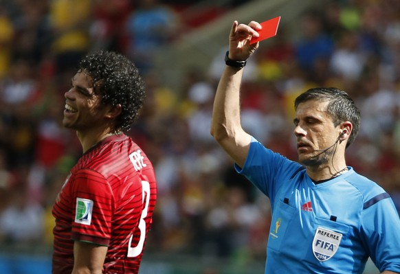 Portugal's Pepe is shown the red card by referee Milorad Mazic of Serbia (R) for committing a rough foul against Germany's Thomas Mueller (not pictured) during their 2014 World Cup Group G soccer match at the Fonte Nova arena in Salvador, June 16, 2014. REUTERS/Jorge Silva (BRAZIL  - Tags: SOCCER SPORT WORLD CUP TPX IMAGES OF THE DAY)