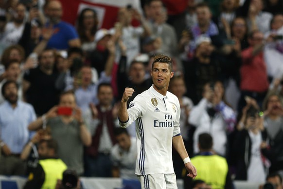 Real Madrid's Cristiano Ronaldo celebrates scoring his side's 2nd goal during the Champions League semifinal first leg soccer match between Real Madrid and Atletico Madrid at the Santiago Bernabeu stadium in Madrid, Spain, Tuesday, May 2, 2017. (AP Photo/Francisco Seco)
