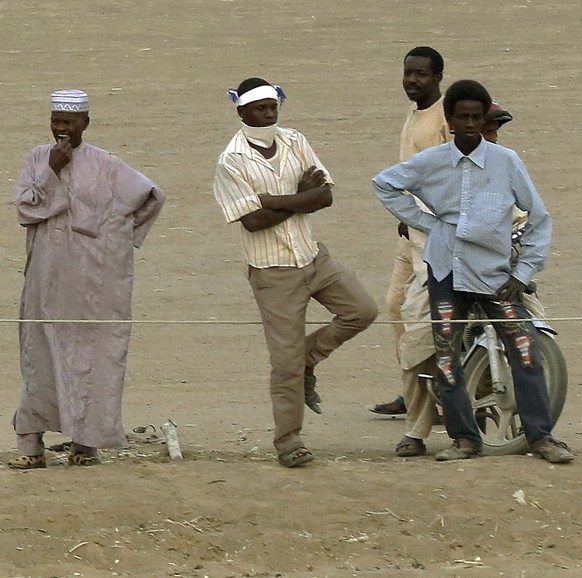 A Chadian rider crosses the finish line after the last race during an afternoon of races at the hippodrome in N'djamena, Chad, Sunday March 15, 2015. Horse races take place every Sunday, bringing hundreds of spectators willing to brave the excruciating heat to watch their favorite sport.(AP Photo/Jerome Delay)