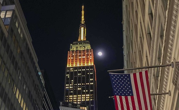 Together with NYC Congresswoman Grace Meng & Partnership for New York City, the Empire State Building is lit gold and black in solidarity with the #StopAsianHate campaign, Friday March 26, 2021, in New York. (AP Photo/Bebeto Matthews) Empire State Building