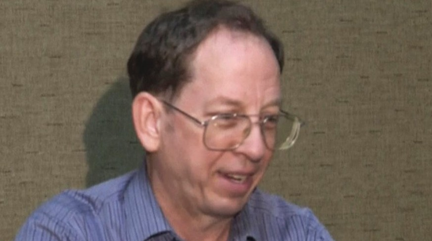 "In this image taken from video, U.S. citizen Jeffrey Edward Fowle speakd at an undisclosed location in North Korea Friday, Aug. 1, 2014. Two Americans, Fowle and Matthew Todd Miller, charged with ""anti-state"" crimes in North Korea say in a video that they expect to be tried soon and possibly receive long prison terms, and appeal for help from the U.S. government. They made the comments in the video shot by a local AP Television News crew. The crew was taken to a location to meet the detained Americans after repeated requests to North Korean authorities to see them. (AP Photo/APTN)"