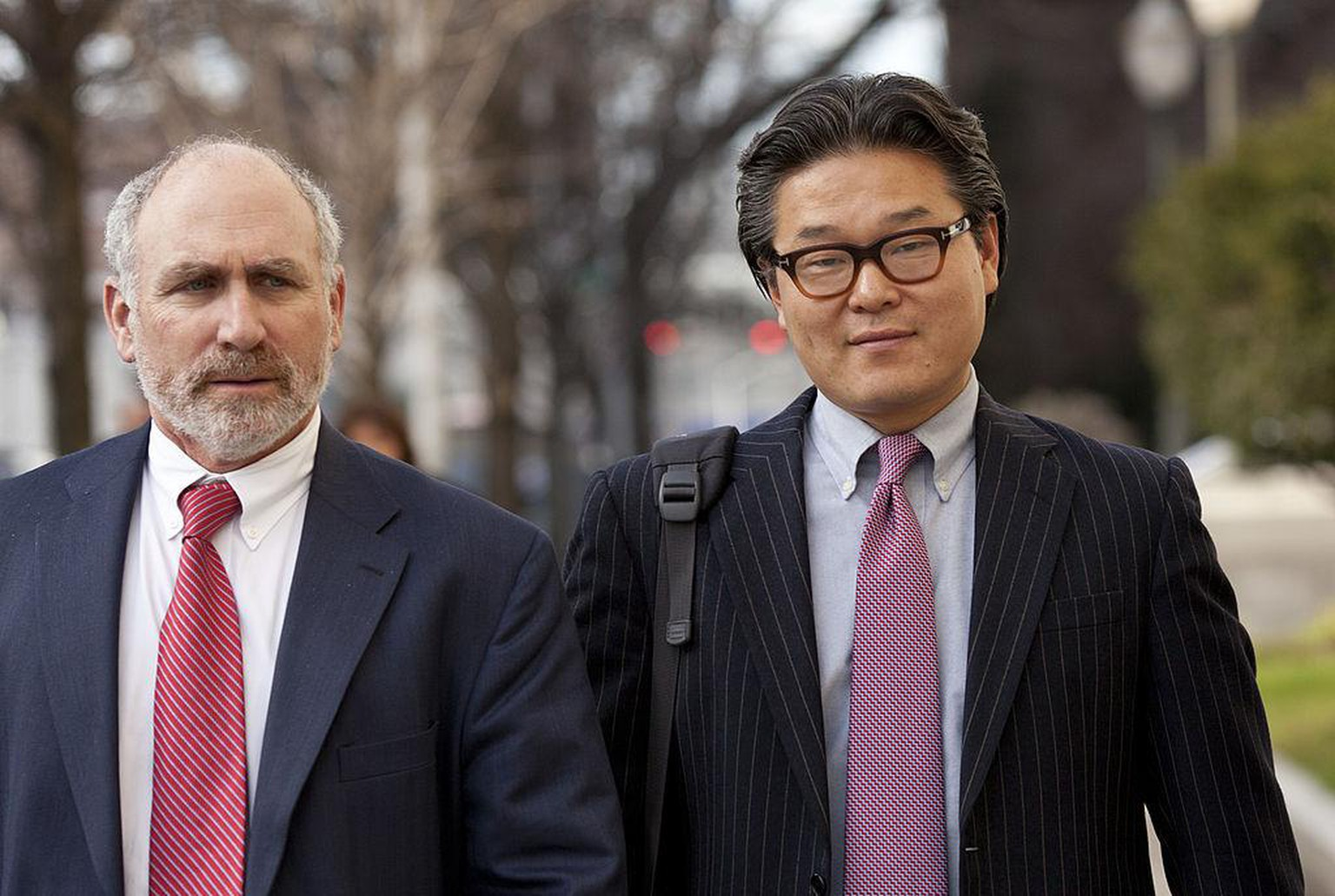 Bill Hwang, founder of of Tiger Asia Management LLC, right, exits federal court with his attorney Lawrence Lustberg in Newark, New Jersey, U.S., on Wednesday, Dec. 12, 2012. Tiger Asia Management LLC, the New York-based hedge fund run by Hwang, pleaded guilty to a wire fraud charge and will forfeit $16.3 million in a U.S. insider-trading case. Photographer: Emile Wamsteker/Bloomberg via Getty Images