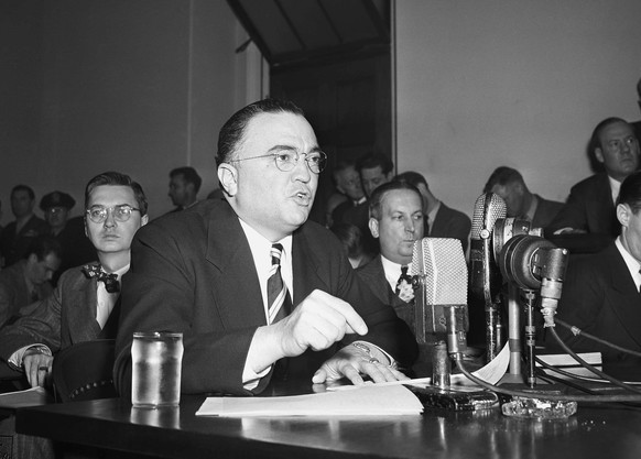 FILE - This March 26, 1947, file photo shows Federal Bureau of Investigation Director J. Edgar Hoover calling the communist party of the United States a