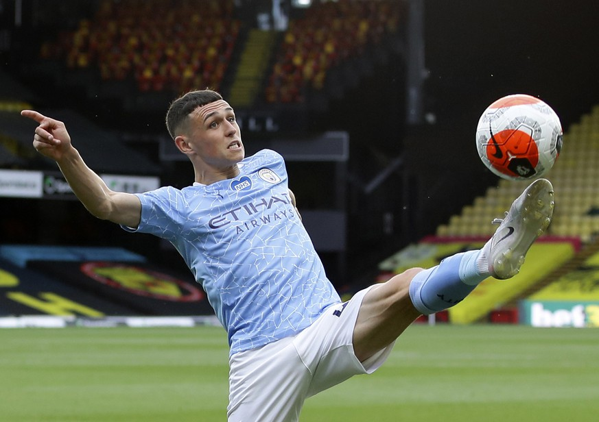 FILE - In this Tuesday, July 21, 2020 file photo, Manchester City's Phil Foden kicks the ball during the English Premier League soccer match between Watford and Manchester City at the Vicarage Road Stadium in Watford, England. England players Phil Foden and Mason Greenwood have been dropped for Tuesday's game against Denmark after breaching coronavirus rules in Iceland. They will return to England from Reykjavik rather than traveling to Copenhagen on Monday Sept. 7, 2020, after social media video was published in Iceland purporting to show the players meeting women from outside the team bubble. (Richard Heathcote/Pool via AP, File)