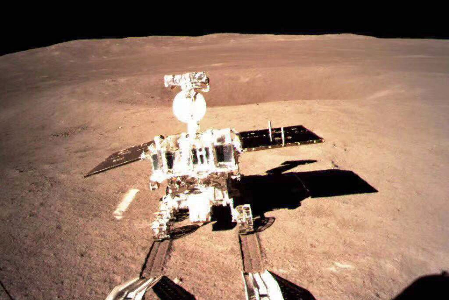 epa07261770 A handout image provided by the China National Space Administration (CNSA) on 04 January 2019 shows the lunar rover Yutu-2 or Jade Rabbit 2 on the far side of the moon taken by China's Chang'e-4 lunar probe on 03 January 2019. China's Chang'e-4 lunar probe made the historic first ever soft landing on the far side of the moon on 03 January 2019 at 10.26am Beijing time (0226 GMT). It is the first spacecraft soft-landing on the moon's uncharted side that was never explored or visible from Earth.  EPA/CNSA / HANDOUT EDITORIAL USE ONLY/NO SALES HANDOUT EDITORIAL USE ONLY/NO SALES