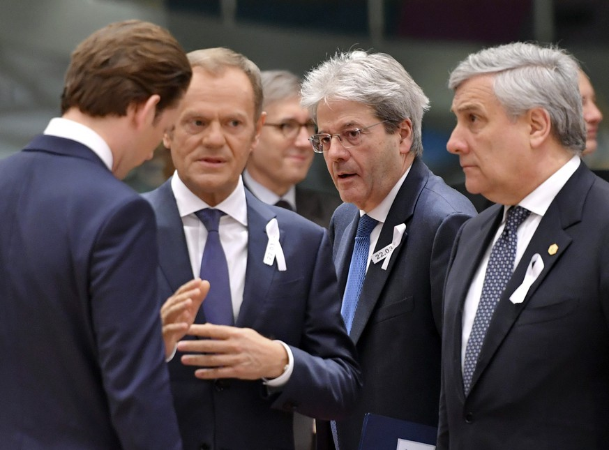 European Council President Donald Tusk, second left, speaks with from left, Austrian Chancellor Sebastian Kurz, Italian Prime Minister Paolo Gentiloni and European Parliament President Antonio Tajani during a round table meeting at an EU summit at the Europa building in Brussels on Thursday, March 22, 2018. Leaders from the 28 European Union nations meet for a two-day summit to assess the state of Brexit negotiations, the prospect of a trade war with the United States and how to react to Russia following to the nerve agent attack in Britain. (AP Photo/Geert Vanden Wijngaert)