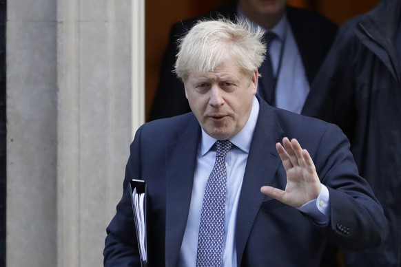 British Prime Minister Boris Johnson leaves 10 Downing Street, to go to the Houses of Parliament in London, Saturday, Oct. 19, 2019. Britain's Parliament is set to vote in a rare Saturday sitting on Prime Minister Boris Johnson's new deal with the European Union, a decisive moment in the prolonged bid to end the Brexit stalemate. Various scenarios may be put in motion by the vote. (AP Photo/Kirsty Wigglesworth)