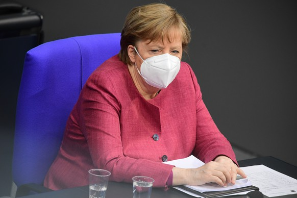epa09138710 German Chancellor Angela Merkel wears a face mask as she looks on during a session of the German parliament Bundestag in Berlin, Germany, 16 April 2021. The German parliament consults about a change of the Protection against Infection Act(Infektionsschutzgesetz). With the changes discussed, the federal government shall be granted with more power regarding the enforcement of Coronavirus measures in the federal states.  EPA/CLEMENS BILAN