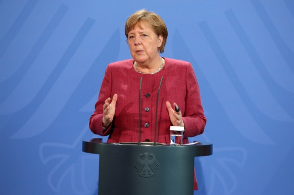 epa09218305 German Chancellor Angela Merkel (CDU) speaks after participating in the Global Health Summit in Berlin, Germany, 21 May 2021. The summit, held in Rome and online amidst the ongoing coronavirus (COVID-19) pandemic as part of Italy's G20 Presidency, is aiming to develop a 'Rome Declaration' with principles to guide multilateral cooperation and action to prevent future global health crises.  EPA/ADAM BERRY / POOL