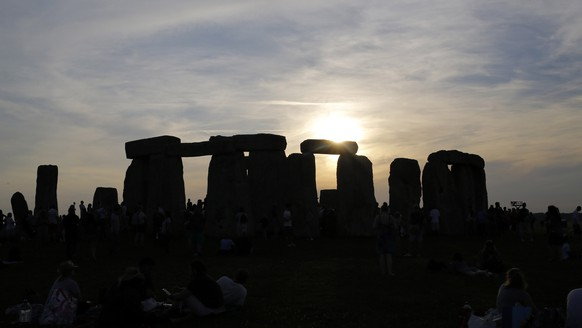 epa06040323 The 'stones' silhouetted against the setting sun during the summer solstice festival at Stonehenge, Salisbury, Britain, 20 June 2017 (Issued 21 June 2017). The annual festival attracts hundreds of people to the 5000 year old stone circle to mark the longest day in the northern hemisphere. sunrise was at 4.52am and was celebrated by dancing, music, and ritualistic events around the stones.  EPA/KIM LUDBROOK