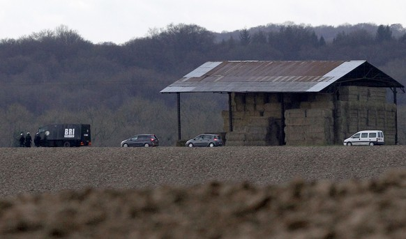 French armed police officers patrol near a farm as they search for suspects in Wednesday's attack at the Paris offices of the newspaper Charlie Hebdo, in Longpont, northeast of Paris, Thursday, Jan. 8, 2015. Masked gunmen stormed the Paris offices of a weekly newspaper Wednesday that caricatured the Prophet Muhammad, killing at least 12 people, including the editor, before escaping in a car. It was France's deadliest postwar terrorist attack. (AP Photo/Michel Spingler)