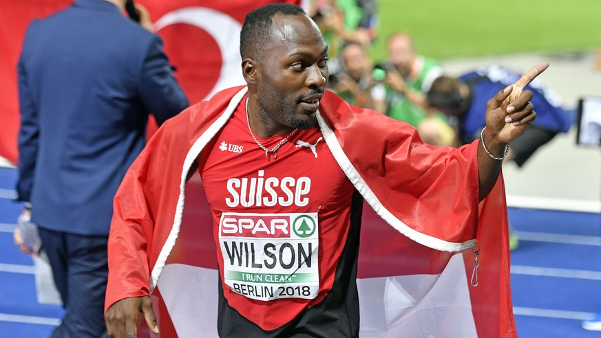 Switzerland's Alex Wilson celebrates after win the bronze medal in the men's 200m final at the 2018 European Athletics Championships in the Olympiastadion stadium in Berlin, Germany, Thursday, August 09, 2018. The 2018 European Athletics Championships will be held in Berlin from August 06 until 12, 2018. (KEYSTONE/Walter Bieri)