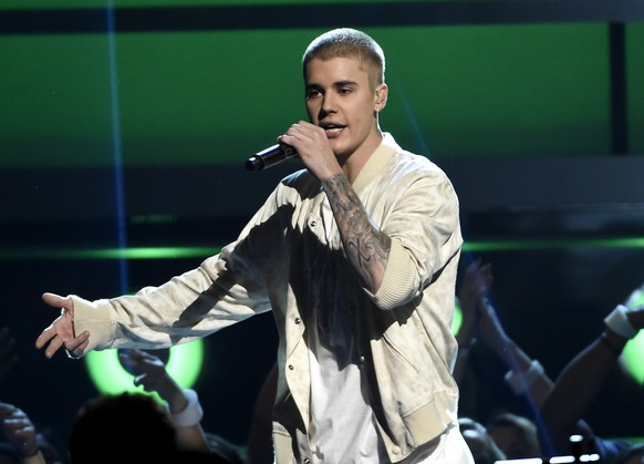 "FILE - In this May 22, 2016 file photo, Justin Bieber performs at the Billboard Music Awards in Las Vegas. Bieber walked off the stage during his show in Manchester, England, Sunday after some fans ignored his request to stop screaming as he was trying to talk to the crowd in between songs. Bieber returned to the stage and told the crowd he'd stop talking and just do his musical set, because he said ""Manchester just can't handle it."