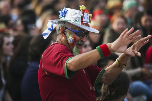 epa05365216 A supporter of Portugal during the public viewing of the UEFA EURO 2016 group F preliminary round match between Portugal and Iceland at Terreiro do Paco in Lisbon, Portugal, 14 June 2016.  EPA/JOSE SENA GOULAO