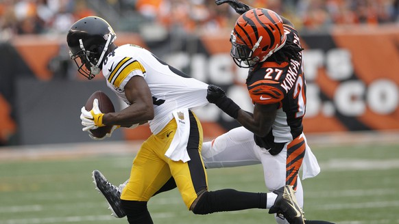 Dec 13, 2015; Cincinnati, OH, USA; Cincinnati Bengals cornerback Dre Kirkpatrick (27) tackles Pittsburgh Steelers wide reciever Antonio Brown (84) in the first half at Paul Brown Stadium. Mandatory Credit: Mark Zerof-USA TODAY Sports