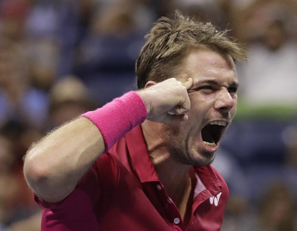 Stan Wawrinka, of Switzerland, reacts after winning the third set against Kei Nishikori, of Japan, during the semifinals of the U.S. Open tennis tournament, Friday, Sept. 9, 2016, in New York. (AP Photo/Julio Cortez)