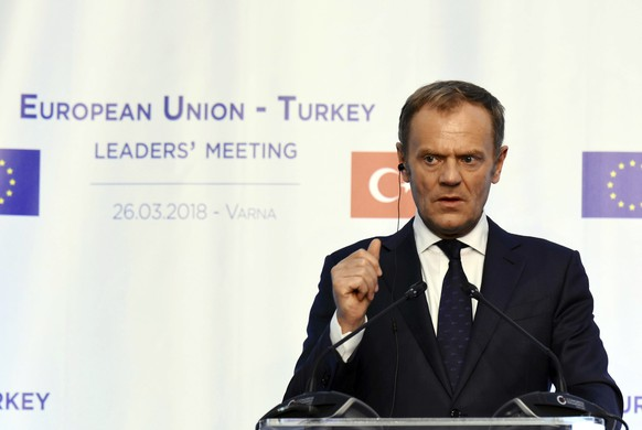 European Council President Donald Tusk gestures during joint news conference after an EU-Turkey summit meeting in Varna, Bulgaria, Monday, March 26, 2018.  (Petko Momchilov/ImpactPressGroup via AP)
