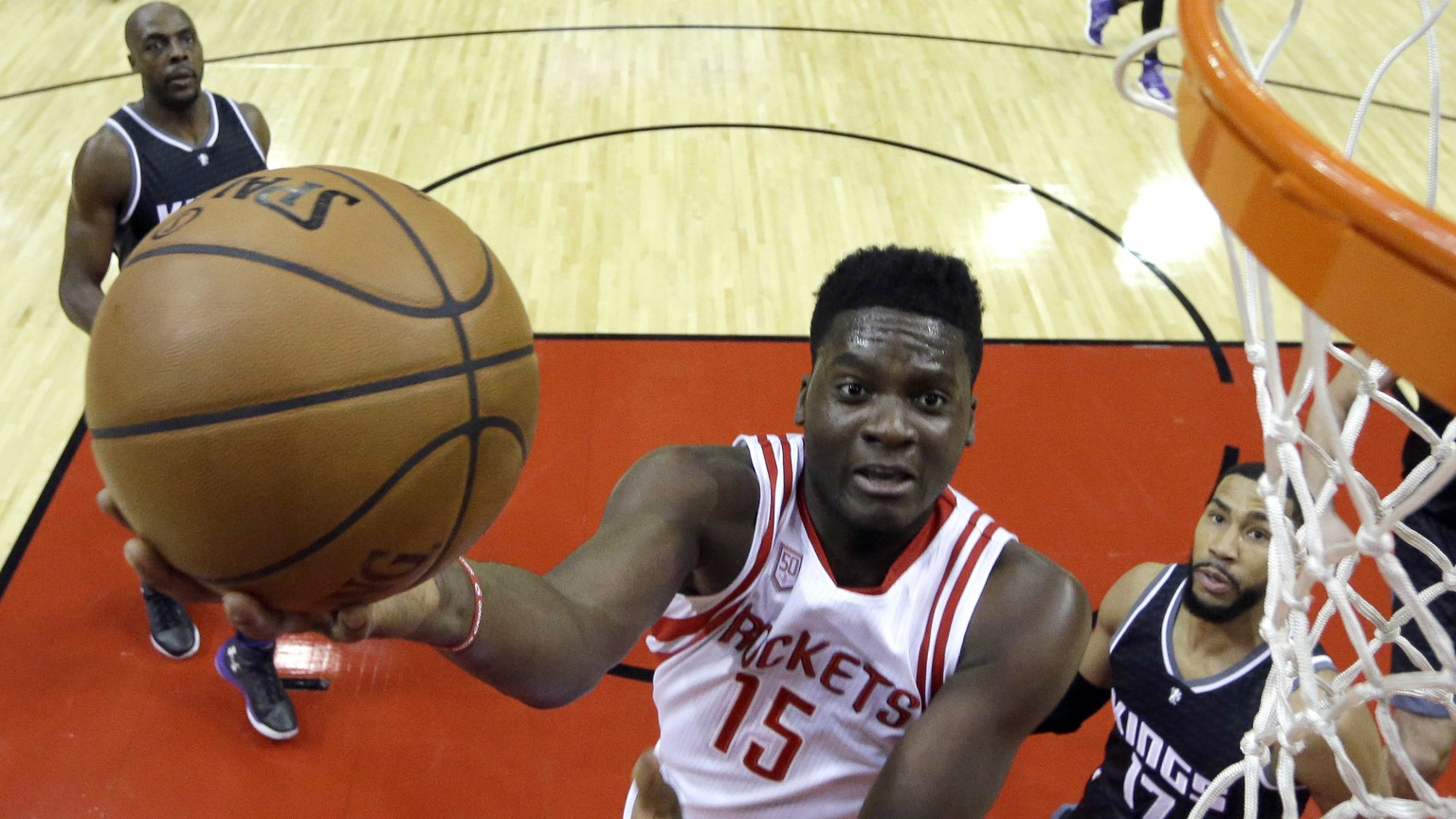 Houston Rockets' Clint Capela (15) shoots as Sacramento Kings' Garrett Temple (17) defends during the first half of an NBA basketball game Wednesday, Dec. 14, 2016, in Houston. (AP Photo/David J. Phillip)
