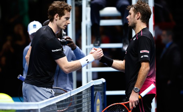 LONDON, ENGLAND - NOVEMBER 20:  The defeated  Andy Murray of Great Britain shakes hands with Stan Wawrinka of Switzerland following the men's singles match on day six of the Barclays ATP World Tour Finals at the O2 Arena on November 20, 2015 in London, England.  (Photo by Julian Finney/Getty Images)