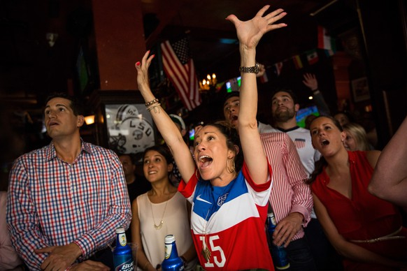 NEW YORK, NY - JUNE 26: Brooke Aguirre (C), a United States Men's National Team fan, reacts while watching the United States versus Germany in the World Cup on June 26, 2014 in New York City. Germany won 1 - 0, though both the United States and Germany will advance to the knock out round.   Andrew Burton/Getty Images/AFP == FOR NEWSPAPERS, INTERNET, TELCOS & TELEVISION USE ONLY ==
