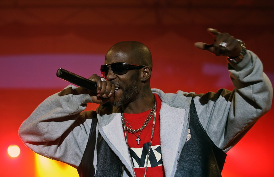 epa09114255 (FILE) - US rapper and actor DMX (Earl Simmons) performs on stage during his concert at Warsaw Challenge 2014 in Sowinski Park, Warsaw, Poland, 11 May 2014 (reissued 03 April 2021). According to media reports US rapper DMX was hospitalized late 02 April 2021 in a critical state.  EPA/RAFAL GUZ POLAND OUT *** Local Caption *** 51362124