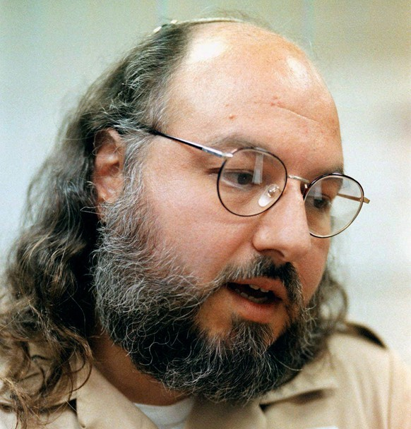FILE - In this May 15, 1998 file photo, Jonathan Pollard speaks during an interview in a conference room at the Federal Correction Institution in Butner, N.C. Lawyers for the convicted spy Pollard say the U.S. has granted his parole and he will be released in November. Pollard, sentenced to life in prison, has served 30 years for spying for Israel.  (AP Photo/Karl DeBlaker, File)