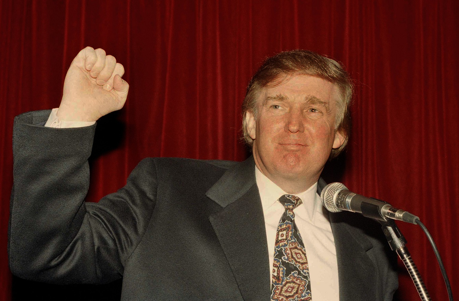 Donald Trump raises his fist at a news conference New York where he denounced a New York Post report that the Sultan of Brunei is interested in buying the Plaza, the landmark hotel overlooking Central Park, Dec. 21, 1994. Trump, who operates the Plaza, threatened to sue the Post for $500 million after the paper reported that the Sultan had bid $300 million to snatch the Plaza from his control. (AP Photo/Marty Lederhandler)