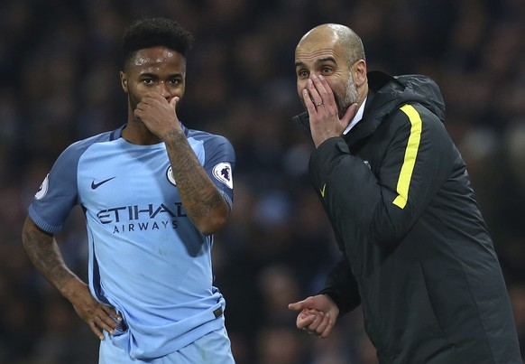 Manchester City manager Pep Guardiola and Manchester City's Raheem Sterling during the English Premier League soccer match between Manchester City and Arsenal at the Etihad Stadium in Manchester, England, Sunday, Dec. 18, 2016. (AP Photo/Dave Thompson)