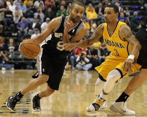 Mar 31, 2014; Indianapolis, IN, USA; San Antonio Spurs guard Tony Parker (9) dribbles the ball as Indiana Pacers guard George Hill (3) defends during the fourth quarter at Bankers Life Fieldhouse. The Spurs won 103-77. Mandatory Credit: Pat Lovell-USA TODAY Sports