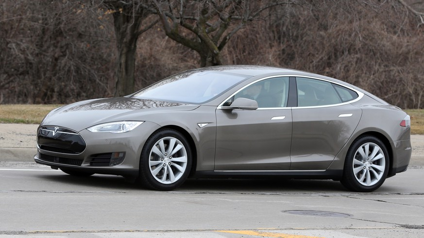 In a photo from Tuesday, April 7, 2015 in Detroit,  a Tesla Model S 70D is seen during a test drive. Electric car maker Tesla Motors is seeking mainstream luxury buyers by adding all-wheel-drive and more range and power to the base version of its only model. The added features for the base Model S come with about a 7 percent price increase to $75,000. Starting Wednesday, Tesla will stop selling the old base Model S called the 60 and replace it with the 70-D. The new car can go 240 miles per charge and from zero to 60 in 5.2 seconds. (AP Photo/Carlos Osorio)