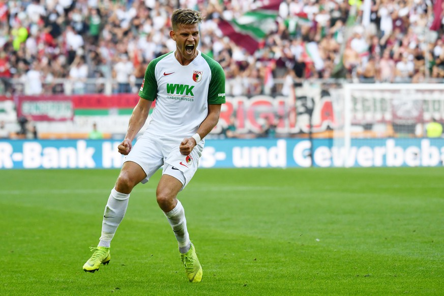 epa07842166 Augsburg's Florian Niederlechner celebrates scoring the 2-0 goal during the German Bundesliga soccer match between FC Augsburg and Eintracht Frankfurt in Augsburg, Germany, 14 September 2019.  EPA/PHILIPP GUELLAND CONDITIONS - ATTENTION: The DFL regulations prohibit any use of photographs as image sequences and/or quasi-video.