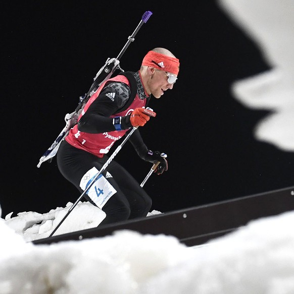 epaselect Erik Lesser of Germany in action during the Men's Biathlon 4 x 7,5 km Relay race at the Alpensia Biathlon Centre during the PyeongChang 2018 Olympic Games, South Korea, 23 February 2018.  EPA/FILIP SINGER