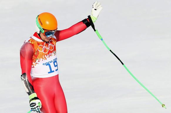 epa04080527 Patrick Kueng of Switzerland in action during the Men's Super G race at the Rosa Khutor Alpine Center at the Sochi 2014 Olympic Games, Krasnaya Polyana, Russia, 16 February 2014.  EPA/ANTONIO BAT