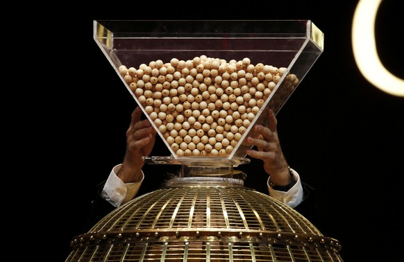 Lottery balls are dropped into a rotating drum before the start of Spain's Christmas Lottery