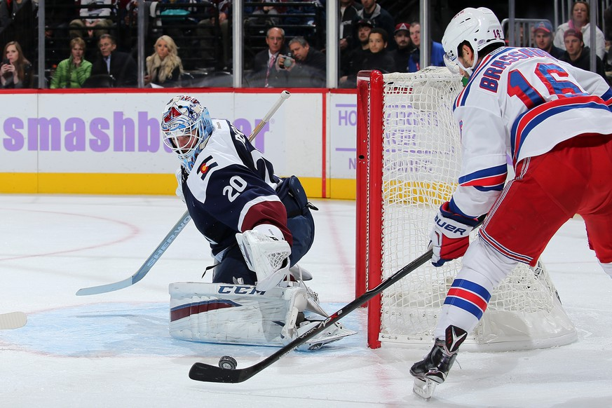 DENVER, CO - NOVEMBER 06:  Goalie Reto Berra #20 of the Colorado Avalanche defends against a shot by Derick Brassard #16 of the New York Rangers at Pepsi Center on November 6, 2015 in Denver, Colorado.  (Photo by Doug Pensinger/Getty Images)