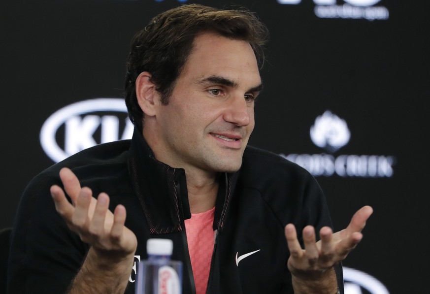 Switzerland's Roger Federer gestures during a press conference following his semifinal win over South Korea's Hyeon Chung when he retired injured at the Australian Open tennis championships in Melbourne, Australia, Friday, Jan. 26, 2018. (AP Photo/Vincent Thian)