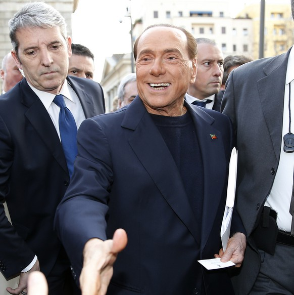 Italian former Premier Silvio Berlusconi arrives to join a demonstration to ask more security along the streets, in Milan, Italy, Saturday, March 11, 2017. (AP Photo/Antonio Calanni)