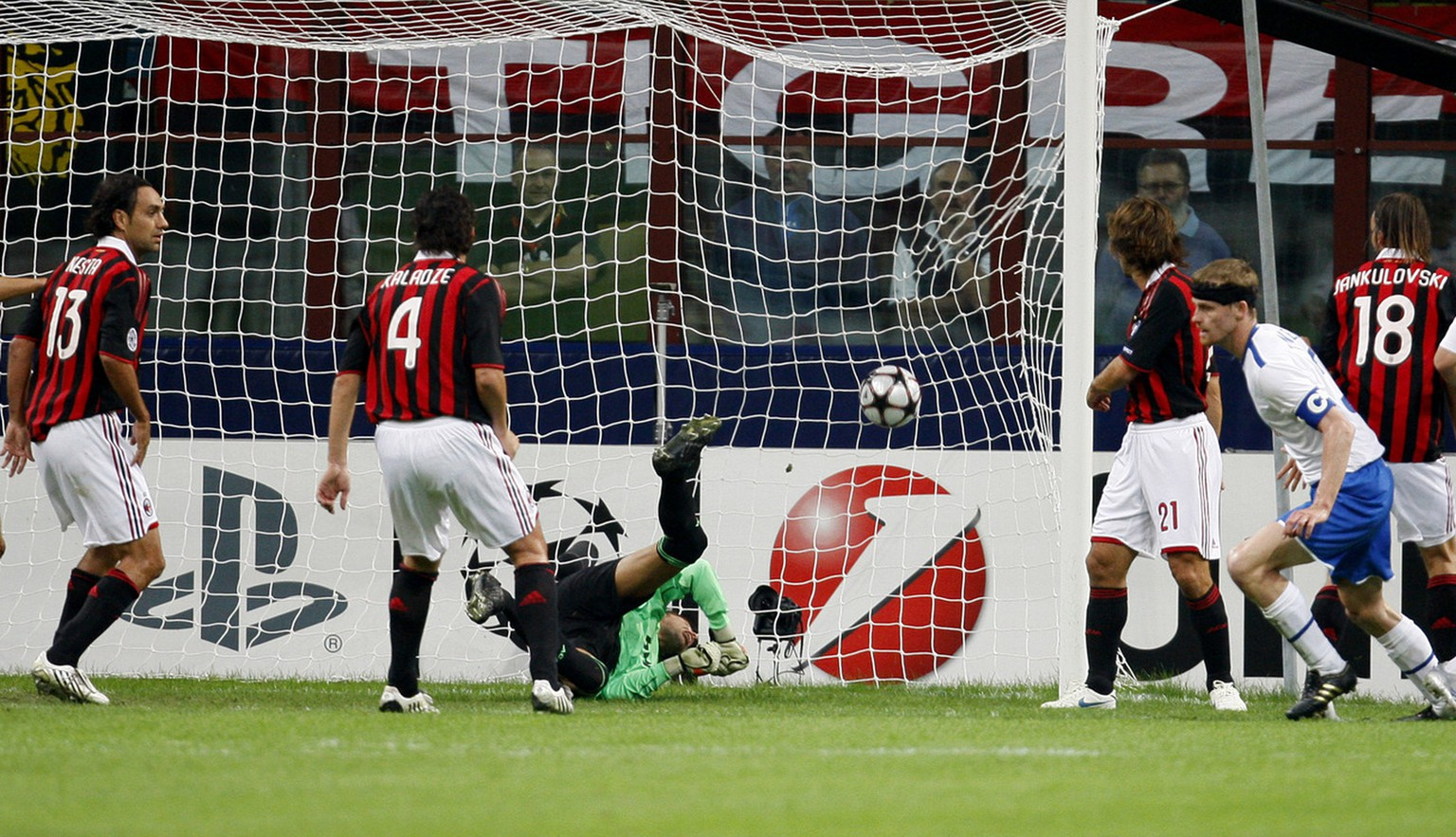 Zurich defender Hannu Tihinen, right in blue shorts, of Finland, scores a goal during the Champions League, group C, soccer match between AC Milan and FC Zurich at the San Siro stadium in Milan, Italy, Wednesday, Sept. 30, 2009. (AP Photo/Antonio Calanni)