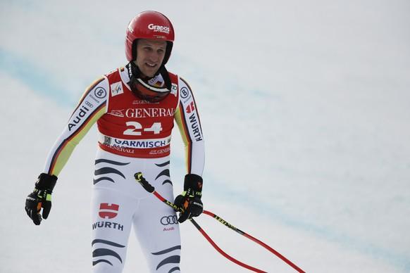 Germany's Josef Ferstl skis down after falling during an alpine ski, men's World Cup downhill, in Garmisch-Partenkirchen, Germany, Friday, Feb. 5, 2021. (AP Photo/Gabriele Facciotti)